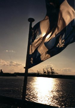 The fleur-de-lis leads a ship to harbour near Quebec City